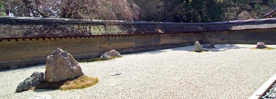 The famous Japanese garden in the karesansui style at Ryoanji, a famous Zen Buddhist temple in Kyoto, Japan